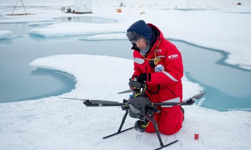 Roberta Pirazzini prepares a drone for flight over the Arctic.